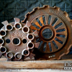 "Antique Industrial Gear Decor - Fantastic set of old gears of thick cast iron in hardcore industrial designs. Engraved text to make them even more intriguing! Reclaimed lumber display stand. Gears measure 5 1/2"" and 7 5/8"" in diameter."