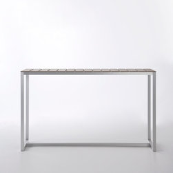 Gandia Blasco - Gandia Blasco Atlantic Bar Table - Large - The Atlantic Bar Table is made of anodized aluminum or powder coated aluminum. The structure is a 100 percent recyclable material called NOWOOD that combines natural and plastic fibers to create a warm wooden texture. The frame is available in three finishes: silver, white, or bronze. Price includes shipping to the US. Manufactured by Gandia Blasco.