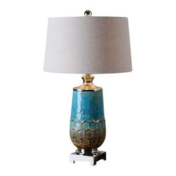 Uttermost Manzu Blue Ceramic Table Lamp - Distressed metallic blue ceramic with rust brown accents and polished nickel plated details. Distressed metallic blue ceramic with rust brown accents and polished nickel plated details. The slightly tapered round hardback shade is a light oatmeal linen fabric.