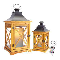 "Asian Import + USA - Floridian - Natural Pine Lanterns with Flameless Color Candles - The Key West Lantern Collection is the perfect blend of traditional""and tropical designs with Caribbean influences.""The Floridian""s solid pine wood framing has a beautiful natural finish. Four clear glass panels reflect candlelight through crossbar""grillwork for a thoroughly stylish lighting accent. The doors close with a dark brass colored latch, a black metal hood and ready to hang or placed on a tabletop. Sizes are 13"" and 20"" tall. Included are 4"" and 6"" Avion Select melted edge color candles with remote control timer. Note that candles pictured are for presentation only. The candles included in the set are described above. Set of 2"