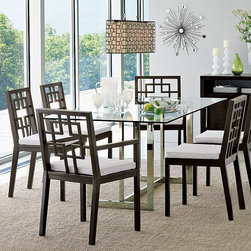 Hicks Glass Top Dining Table - Dining with a sleek, urban-chic edge. Expansive glass tabletop rests upon a gleaming metal base.