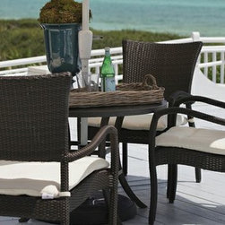 Outdoor Furniture For Oceanfront Houses - This year enjoy Summer Classics Skye dining set. Our stackable outdoor wicker furniture has cloudlike curves and is fully woven for worry-free coastal enjoyment!