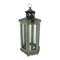 Rustic Distressed Finish Gray Lantern Candle Holder Hexagon - This beautiful metal, resin and glass hexagonal lantern style candle holder has a wonderfully rustic, distressed gray enamel finish finish. The lantern features an antiqued brass opener on the top door, and has a heat resistant silvered plate on the bottom for safety. It has a hanger ring on top, so you can hang it from eaves or trees, and has a flat bottom, so it can be displayed on tables or decks. The lantern is 17 inches tall (18 inches including the hanger), 8 inches wide and 8 inches deep. It can accept pillar candles up to 3 inches in diameter and 7 inches tall. It makes a great gift for friends and family.
