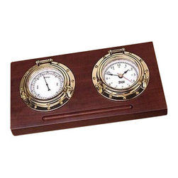 """Weems & Plath Porthole Desk Set - The Porthole Desk Set includes a clock and barometer that are set into a mahogany finish base made from solid North American hard wood. The polished brass finish is tarnish free and never scratch. There is an indentation in the wood base for a pen and rubber feet under the base to protect the desk or shelf. Battery and brass plate suitable for engraving are included. This product has a lifetime warranty. It measures 10-1/4"""" W x 2"""" H."""" 5-1/4"""" D."""