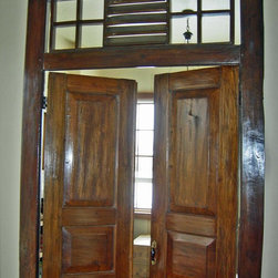 Salvaged / Reclaimed Teak Door & Frame From East Java - An antique Javanese door, hand hewn from old growth teak, is installed in a contemporary house in Garden City, Idaho.  This door adds great character, interest and texture to this newly-built home.