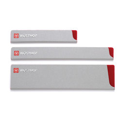 Wusthof - Wusthof Three Piece Blade Guard Set - Protect your valuable Wüsthof knives with this set of three Wüsthof Blade Guards. Comprised of one Narrow Blade Guard for short knives, one Narrow Blade Guard for medium length blades, and one Wide Blade Guard for medium length knives, this set is a convenient way to making sure your three most popular knives are well-protected. These three blade guards provide accommodations for one narrow, short blade such as a peeling or paring knife, up to 4.5 in length, one narrow, medium length blade such as a tomato, boning, fillet, sandwich, carving, bread, or utility knife knife up to 8 in length, and one wide, medium length blade such as the popular 8 cooks knife, or a santoku or nakiri. Shield your fine blades from scratches whether stored in a kitchen drawer or carried around in a portable knife case. Blade guards also provide safety for fingers of the unaware when probing around the drawer.