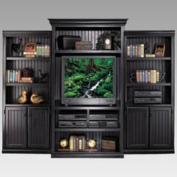 kathy ireland Home by Martin Southampton Wall Bookcase - Black - If you're seeking a stylish storage solution, the kathy ireland Southampton Wall Bookcase - Black is your answer. Crafted from durable hardwood solids and veneers, this three-piece unit holds your book collection, displays your favorite mementoes, and organizes your home entertainment equipment. Stylish and sturdy, this spacious wall bookcase has a distressed black finish and vertical slat molding. The charming and casual New England style suits a number of decor schemes, while eight adjustable and seven fixed-height shelves offer arrangement flexibility.With its removable center back panel and wire management cover, the middle bookcase makes an ideal TV armoire. The TV space measures 37W x 19.25D x 30H inches. A two-door lower cabinet on each side provides hidden storage space - perfect for storing DVDs, CDs, and more. This package includes two kathy ireland Southampton Wood Bookcases with Doors - Black and one kathy ireland Southampton Deluxe Wood Bookcase - Black. It comes with a 10-year manufacturer's warranty. Fully assembled for convenience and immediate use.Dimensions:Overall: 105.5W x 21.5D x 78H inchesBookcase: 45.5W x 21.5D x 78H inchesBookcase with Doors: 30W x 12.5D x 73H inchesAbout kathy ireland Home by Martin FurnitureA well-known industry-leading manufacturer of home office and home entertainment furniture, kathy ireland Home by Martin exemplifies kathy ireland's mission statement: Finding solutions for families, especially busy moms. As Chief Designer, Kathy collaborates with kathy ireland Home by Martin and kathy ireland Office by Martin on the design and marketing of each and every furniture collection. Each collection is designed and constructed with four words in mind: fashion, quality, value, and safety.About Martin FurnitureMartin Furniture was founded in 1980 by Gil Martin in the San Diego suburb of El Cajon. Martin started the company in his garage with $400, a Craftsman table saw, and the business knowledge he gained from working for defense contractor, General Dynamics. Today, Martin Furniture specializes in American-made and imported office and home entertainment furniture. In 2003, it teamed up with kathy ireland's design company kathy ireland Home, creating furniture solutions for families. Martin also offers classically hip collections designed by musician Curt Christian, featuring functional, high-quality furniture for today's lifestyle.Boasting solid growth in sales over the past 25 years, Martin Furniture's success can also be measured by the satisfaction of its customers. Its operation now includes, among other resources, a 250,000 square-foot facility in San Diego. In addition to the bookshelves found here, Martin has a vast collection of flooring, rugs, lighting, wall art, accessories, home office, and general home furniture for all budgets.