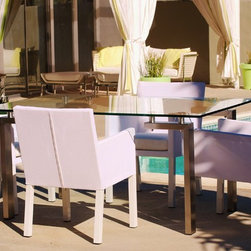 outside/in modern outdoor furniture - outside/in deepwell rectangular dining table (stainless steel, tempered glass) with las palmas dining chairs (powder coated aluminum frame, textilene mesh cover)