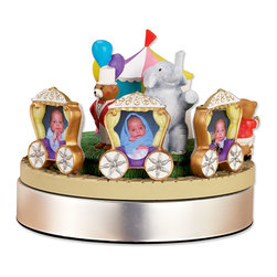 "Lawrence Frames - Wind Up Musical Circus Train Frame - Holds Three 2x3 Photos - Adorable Circus Carousel Picture Frame.  Wind-up circus train holds three 2x3 wallet photos while circling the tent and playing the classic circus tune ""Entrance of the Gladiators.""  A teddy bear ring master waits by the entrance with a very cute sitting elephant.  Comes with a timeless nursery book ""We're going to the Circus"" starring the same characters featured on the carousel."