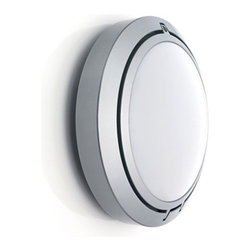 """Luceplan - Metropoli D20/27 Outdoor Light - Features: . -Outdoor ceiling/wall light. -Metropoli collection. -Available in black or white. -Polycarbonate diffuser. -ADA compliant when mounted on wall . -Suitable for wet locations Specifications: . -ADA compliant when mounted on wall . -UL listed . -Suitable for wet locations. -Uses compent D20/27.4 for 2 X 18W G24q2 based electronic compact fluorescent bulbs (not included). -Uses component D20/27.5 for 2 X 13W GX23-2 based magnetic compact fluorescent bulbs (not included). -Replacement bulb available - please call to order. -Overall Dimensions: 10"""" H x 10"""" W x 4.2"""" D"""