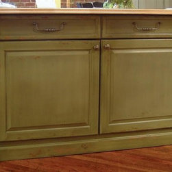 British Traditions - 7 Ft. Wide Country Kitchen Island w 2 Long Drawers & 2 Cabinets (Antique White) - Finish: Antique White. Each finish is hand painted and actual finish color may differ from those show for this product. Elegant country kitchen island. 2 Long drawers. 2 Cabinets. Fluted columns hide storage shelves. Ships in 2 sections in 1 box. Minimal assembly required. Cabinet size: 32 in. W x 24 in. D x 22.5 in. H. 84 in. L x 30 in. W x 36 in. H (578 lbs.)The Mayfair island dresses up any kitchen. It features two narrow, full-height pullouts, one at each end of the island, cleverly concealed by what appear to be fluted columns with decorative capitals. The pullout behind each column has three adjustable shelves - excellent for storing spices or cleaning materials or breads or tins of tea! The unit also has two large two-door cupboards underneath, as well as two wide drawers over the cupboards. The top is easy-care butcher block.