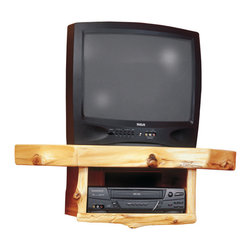 Log Corner Television Shelf with VCR/DVD Shelf - Conserve space with the Corner TV Shelf with VCR/DVD Shelf. Individually hand crafted from Northern White Cedar logs this piece lets you add entertainment media to any space. Mounting strip under TV shelf for rigid support of up to a 21 Inch TV. Cord grommet to allow cords to run behind TV. Clear-coat catalyzed lacquer finish accentuates the natural character and beauty of each hand peeled log. Measures 34 Inch W x 24 Inch D.