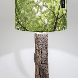 "DRIFTWOOD TABLE LAMP - Evoking nature, sunlight and life. With a driftwood rescued from the sea at La Parguera, Puerto Rico.The image on lamp shade was taken in Central Park, New York City. They are the trees that grow and give shade to the ""Imagine"" Strawberry Fields Memorial to John Lennon. The name we give to this lamp shade was ""Imagine""."