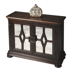 Butler Specialty - Butler Console Cabinet - Handcrafted from gemelina wood solids, wood products and choice maple veneers, this attractive console cabinet features a tiered base and an immaculate window panel design with arresting antique-mirror treatments on door panels. Boasts ample storage with an adjustable shelf behind the doors. Lightly distressed, antiqued dark walnut finish.