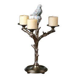 Uttermost - Birdella Candleholder - This nightingale has more than just a song to offer you. Illuminate your evenings with this silver-tree branch candelabra featuring a distressed ceramic songbird. Its moulded detail and visual weight make it a distinctive centerpiece on pianos or dining room tables.