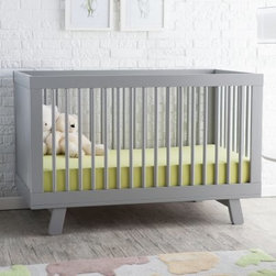 Babyletto Hudson 3 in 1 Convertible Crib Collection - Your child is never too young to enjoy the appealing modern style that's on display in the Babyletto Hudson 3-in-1 Convertible Crib. Rounded spindles are set inside a clean modern frame for a fresh gender-neutral approach to the nursery. The crib's four adjustable mattress positions allow you to maximize comfort and safety for both you and baby. The Hudson 3-in-1 Convertible Crib converts to both a toddler bed (rail included) but becomes a daybed as your child grows (remove the guard rail). This stylish piece is solidly built from sustainable New Zealand pine wood that's available in your choice of safe non-toxic finishes. This special nursery set includes the Babyletto Hudson Changer Dresser and is available in your choice of finish. The Babyletto Hudson Changer Dresser coordinates perfectly with the Hudson 3 -in -1 Convertible Crib. The minimal footprint of the modern-styled piece gives you a changing table a storage cabinet and a three-drawer dresser in one appealing unit. The changing tray up top is removable for easy cleaning. The raised sides of the changing tray will keep your little one from rolling off and an anti-tip kit is included to give this unit additional stability. Deep drawers slide open on smooth metal glides giving you plenty of room and access for all of your child's clothes and must-have items. Safety stops also make sure that the drawers never get pulled out on top of little heads. About BabylettoModern and stylish while remaining affordable and eco-friendly Babyletto is a brand with a vision. Established in 2010 Babyletto takes pride in offering quality products for families all designed to open the heart and spark imagination. Working from a platform based on fond childhood memories and special moments they strive to infuse every design with an essence of honesty and creativity while crafting each piece with impeccable quality. Safety is at the forefront of each and every thing they produce and a long-standing relationship with their producers helps to maintain this commitment as well as their dedication to eco-friendly manufacturing.