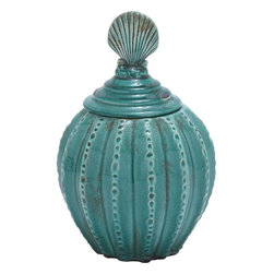 Benzara - Jar with Vibrant Blue Color and Weathered Finish - Decorate the display shelf of your living room and add spice to your home decor with this ceramic jar that defies the ages with its timeless appeal and conventional appearance. It sports a pumpkin-shaped pattern with elegant and evenly distributed ridges that adorn it from the top to bottom. The vibrant blue color with a weathered finish further enhances this jar with great charm and brings a more antique and rustic look to it. The large open mouth is covered by a very delicate lid, which is decorated with shell-like artwork on top of it. Additionally, the elegant pattern on top makes it more convenient to lift off the lid with ease. Since made of high quality ceramic, the color and design of this jar is sure to last longer and will decorate your living space for a lifetime.