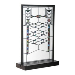 Frank Lloyd Wright 9H in. Robie House - Deck your desk in Deco with the Frank Lloyd Wright 9H in. Robie House table top replica of Wright's stained glass window design from the Robie House, his greatest Prairie Style creation. On a base of clear glass, colorful enamel blocks and triangles, along with strikingly placed metal cames are fused in a geometric pattern using a kiln fire. With its overlapping diamond and chevron designs, this window will add a touch of sophistication and style to your space. It measures 9H x 6W x .125D inches.