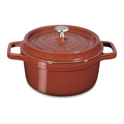 Staub Round Cocotte, Red - This fall-hued cast iron cocotte has fall stews, braises and soups written all over it. Designed with longevity in mind, it will be around for years to come.