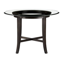 "Halo Ebony Dining Table with 42"" Glass Top - Halo's simple beauty lies in its open presentation of materials, construction and design. The ""halo"" is a trick of light created by the glass top that's perfectly flat on the surface but has a deep, light-refracting reverse bevel on the underside. A solid chestnut wood base echoes the halo with its own center top ring in a deep, rich ebony. Dark, minimal flared legs and an architectural cross-brace of the same wood connect so precisely that no screws or nails are required."