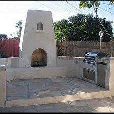 Mediterranean Patio by Custom Masonry & Fireplace Design Inc