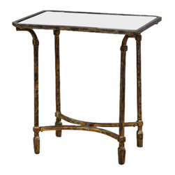 Uttermost Zion Metal End Table - Artisan-forged iron with cast iron details in heavily tarnished gold leaf, inset with sleek, black tempered glass top. Artisan-forged iron with cast iron details in heavily tarnished gold leaf, inset with sleek, black tempered glass top.