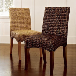 "Sea Grass Chair - These beautiful woven chairs add beachy style and a woven texture to any room you choose. Great for a relaxed dining room or eat-in kitchen, also makes an interesting side chair in a bedroom.  Dimensions: 19"" wide x 20"" deep x 35"" high. Seagrass and abaca; handwoven natural fiber over a solid beech frame."