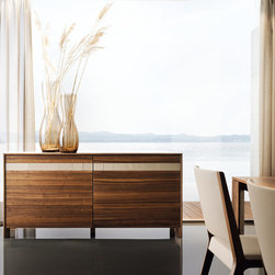 Eviva Modern Walnut Sideboard - With its flush-mounted sliding doors and integrated handle, the modern sideboard (shown here in walnut) is attractive, luxurious and functional. And if additional storage space is needed, it also comes as a highboard. Integrated, flush-fitting flap handles are not only functional to operate - they are also exceptionally attractive and elegant.