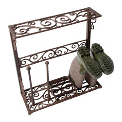 Cast Iron Boot Rack - Did you ever think it was possible to celebrate muddy boots on a rainy day? With this traditional Victorian cast iron boot rack with elegant scroll work, you will be happy to see the muddy boots on this beautiful boot rack instead of on your floor.