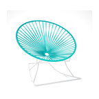 Innit Rocker, White Frame With Turquoise Weave - Metal and vinyl come together seamlessly to form this comfy rocking chair made for indoor or outdoor use. The hoop shape creates a supportive place to rest, and the white metal base keeps you rocking for added relaxation. The woven seat is available in multiple colors to match your every decor need or whim.