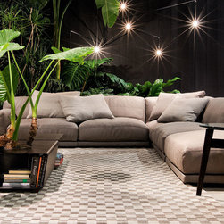 Paris-Seoul Sofa - Paris-Seoul is a sofa, coffee tables and containers collection designed by Jean-Marie Massaud. Its generous