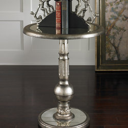 Baina Mirrored Accent Table - Antiqued mirrors accent the base and tabletop of Baina's brushed silver, carved pedestal. Light assembly. It's the perfect finish to set off the intricate fluting and carved detailing. A spherical stand is reflected in the mirrored base, and the matching mirrored top gives intriguing depth to anything you place on it.