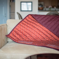 Vintage Sari Throws - Something old, something new: The traditional art of quilting gets a chic, contemporary edge. Designed and handcrafted in New York City, our repurposed vintage saris are artfully cut and arranged to create a beautiful one-of-a-kind throw blanket.