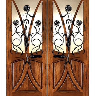 Art Nouveau Entry Doors Model # AN-2004 - Art Nouveau is an art, style, and architecture recognized around the globe.  This door and collection will set you apart from the rest while giving your home a very unique look.  These doors have fine carvings, iron work and most have a operable glass panel to facilitated the cleaning of the iron panel.  Look at the entire collection to find the right fit!