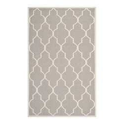 Safavieh - Dhurries Dark Grey and Ivory Rectangular: 5 Ft. x 8 Ft. Rug - - This distinctive piece is both stylish and incredibly soft to the touch with bold rich colors that complement any room. Flat-woven by hand in India  - Pile Height: 0.25  - Construction: Flatweave  - Shedding is a normal occurrence and will reduce over time with frequent vacuuming. It is also recommended that you vacuum regularly to prevent dust and crumbs from settling into the roots of the fibers. AVOID DIRECT AND CONTINUOUS EXPOSURE TO SUNLIGHT. USE RUG PROTECTORS UNDER THE LEGS OF HEAVY FURNITURE TO AVOID FLATTENING PILES. DO NOT PULL LOOSE ENDS, CLIP THEM WITH SCISSORS TO REMOVE. TURN CARPET OCCASIONALLY TO EQUALIZE WEAR. REMOVE SPILLS IMMEDIATELY ; IF LIQUID, BLOT WITH CLEAN, UNDYED CLOTH BY PRESSING FIRMLY AROUND THE SPILL TO ABSORB AS MUCH AS POSSIBLE. FOR HARD TO REMOVE STAINS, PROFESSIONAL RUG CLEANING IS RECOMMENDED. STORE IN A DRY, WELL-VENTILATED AREA. USE OF A RUG PAD IS RECOMMENDED. Safavieh - DHU632G-5