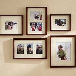 """Gallery in a Box, Modern White Frames, Set of 10 - Our Gallery in a Box set comes with everything you need to easily create a beautiful wall of memories. Choose from a set of six or a set of 10 wood frames with archival mats to add a display in any space. For decorating ideas to transform your walls, {{link path='shop/accessories-decor/gallery-wall-ideas'}}click here{{/link}} to view our Wall Solutions Tool. Set of 6 contains frames listed below: Single-Photo Frame (1): holds one 4 x 6"""" photo 3-Photo Frame (1): holds three 4 x 6"""" photos Single-Photo Frame (2): holds one 5 x 7"""" photo 2-Photo Frame (1): holds two 5 x 7"""" photos Single-Photo Frame (1): holds one 8 x 10"""" photo Set of 10 contains frames listed below: Triple Wood Gallery Frame (2): holds three 4"""" x 6"""" photos Single Wood Gallery Frame (2):  holds one 4"""" x 6"""" photo Single Wood Gallery Frame (3):  holds one 5"""" x 7"""" photo Double Wood Gallery Frame (1): holds two 5"""" x 7"""" photos Single Wood Gallery Frame (2):  holds one 8"""" x 10"""" photo Crafted of alder wood with either a black, white or espresso painted finish. Bevel-cut archival quality mat is included: Black and White frames with a white mat. Espresso with an ivory mat. Includes 3 templates for creating a horizontal, vertical or stairway configuration. View and print our gallery frames style guide, {{link path='/pages/popups/Gallery_Frames.html'}}click here{{/link}}."""
