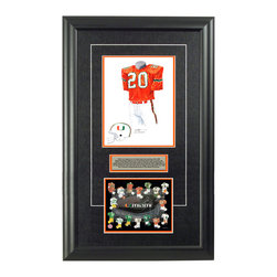 """Heritage Sports Art - Original art of the NCAA 1983 Miami Hurricanes uniform - This beautifully framed NCAA football piece features an original piece of watercolor artwork glass-framed in an attractive two inch wide black resin frame with a double mat. The outer dimensions of the framed piece are approximately 17"""" wide x 28"""" high, although the exact size will vary according to the size of the original piece of art. At the core of the framed piece is the actual piece of original artwork as painted by the artist on textured 100% rag, water-marked watercolor paper. In many cases the original artwork has handwritten notes in pencil from the artist. Simply put, this is beautiful, one-of-a-kind artwork. The outer mat is a rich textured black acid-free mat with a decorative inset white v-groove, while the inner mat is a complimentary colored acid-free mat reflecting one of the team's primary colors. The image of this framed piece shows the mat color that we use (Orange). Beneath the artwork is a silver plate with black text describing the original artwork. The text for this piece will read: This is an original, one-of-a-kind watercolor painting of the 1983 Miami Hurricanes uniform worn by #20 Bernie Kosar and was used in the creation of this Miami Hurricanes uniform evolution print and thousands of Miami products that have been sold across North America. This original piece of art was painted by artist Nola McConnan for Maple Leaf Productions Ltd.  1983 was a National Championship season for the Miami Hurricanes. Beneath the silver plate is a 6.5"""" x 7"""" reproduction of a uniform evolution print that celebrates the history of the team. The print beautifully illustrates the chronological evolution of the team's uniform and shows you how the original art was used in the creation of this print. If you look closely, you will see that the print features the actual artwork being offered for sale. The 6.5"""" x 7"""" print is shown above. The piece is framed with an extremely high qualit"""