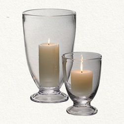 Simon Pearce Cavendish Hurricane - I've been a Simon Pearce fan for years — my mom has wine glasses that I covet every time I go home. The Cavendish Hurricane makes a great statement on a table when paired with a glowing candle.