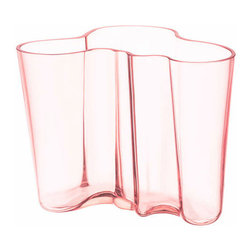 """iittala Aalto Salmon Pink Vase - 6-1/4"""" - One of the fairest colorways to be introduced, the iittala Aalto 6-1/4"""" Salmon Pink Vase is the equivalent of a summer breeze. A delicate rose-orange hue, the softly waving silhouette produces a vase that looks neither solid nor liquid but a harmonious combination of the two. Designed by Alvar Aalto in 1936, his design became popular at the Paris World Fair for its original and captivating design. Perfect as a display piece or enhance a big bushel of flowers by placing it within this gorgeous vase."""