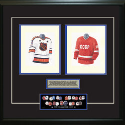 """Heritage Sports Art - Original art of the NHL 1986-87 NHL All-Star jersey - This beautifully framed piece features two pieces of original, one-of-a-kind artwork. Both images are glass-framed in an attractive two inch wide black resin frame with a double mat. The outer dimensions of the framed piece are approximately 28"""" wide x 24.5"""" high, although the exact size will vary according to the size of the original art. At the core of the framed piece is the actual piece of original artwork as painted by the artist on textured 100% rag, water-marked watercolor paper. In many cases the original artwork has handwritten notes in pencil from the artist. Simply put, this is beautiful, one-of-a-kind artwork. The outer mat is a rich textured black acid-free mat with a decorative inset white v-groove, while the inner mat is a complimentary colored acid-free mat reflecting one of the team's primary colors. The image of this framed piece shows the mat color that we use (Medium Blue). Beneath the artwork is a silver plate with black text describing the original artwork. The text for this piece will read: These are original, one-of-a-kind watercolor paintings of both of the 1986-87 NHL All-Star jersey and the Soviet Union jersey. These jersey images have been, and continue to be, used to celebrate the history of the NHL All-Star game in posters like the one shown below as well as game programs, magazines and websites across North America. Beneath the silver plate is a 3"""" x 9"""" reproduction of a well known, best-selling print that celebrates the history of the team. The print beautifully illustrates the chronological evolution of the team's uniform and shows you how the original art was used in the creation of this print. If you look closely, you will see that the print features the actual artwork being offered for sale. The piece is framed with an extremely high quality framing glass. We have used this glass style for many years with excellent results. We package every piece very care"""