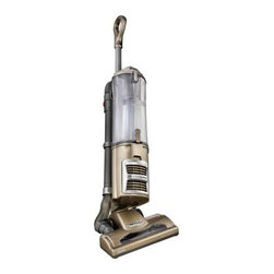 Shark NV70 Navigator 3X Capacity Vacuum with Swivel Steering - Effortlessly deep clean your home with this Shark NV70 Navigator 3X Capacity Vacuum with Swivel Steering. It glides on smooth rubber wheels for easy maneuvering around furniture and other household objects. It's also capable of capturing up to 99.9% of dirt dust and allergens for a cleaner, healthier home environment.About Euro-Pro Operating, LLCEuro-Pro is a pioneer in innovative cleaning solutions and household appliances. They were the creators behind the familiar household brands Shark and Ninja. Euro-Pro provides appliances that are highly functional and cutting-edge. From chemical-free steam mops to top-notch kitchen appliances, Euro-Pro products make daily chores easier. Euro-Pro has offices in Massachusetts, Canada, and China. Mark Rosenzweig is their CEO and is the third generation of his family to lead Euro-Pro.