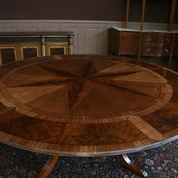 Round Mahogany Pedestal Dining Table With Expandable Perimeter (AP 11 X NP) - Round mahogany dining table shown with leaves, seats 10 people. Round pedestal dining table with inlay.