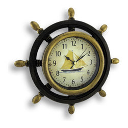 Wooden Look Nautical Ship`s Wheel Wall Clock Sailboat Face - This plastic framed ship`s wheel wall clock features a sailboat printed, distressed finish face face and has standard numeric markers. It has a painted black and gold woodgrain finish. The clock measures 13 inches in diameter and 1 3/4 inches deep. The clock takes a single AA battery. It`s perfect for any room with a nautical theme.