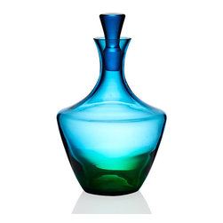 """Frontgate - Kim Seybert Vague Decanter - Designed by Kim Seybert. Heirloom-quality artisanal barware makes a perfect wedding or housewarming gift. 100% handmade glass. Dishwasher-safe. A modern yet timeless heirloom, our Kim Seybert Vague Glass collection breathes fresh life into the ancient art of glass blowing. French for """"wave,"""" each Vague piece is handmade by Eastern European glass masters, with a stunning horizon where blue meets green glass.  .  .  .  . Handcrafted in Czechoslovakia."""