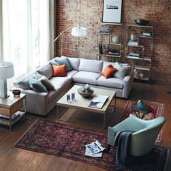 At Bloomingdale's: Mitchell Gold + Bob Williams Carson Sectional - With a rounded back and exposed wooden arms, the Faye chair shows off clean lines and a timeless style that effortlessly blends in with every interior.