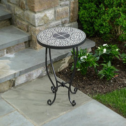Alfresco Home - Alfresco Home Vulcano 16 in. Round Side Table - 28-7513 - Shop for Tables from Hayneedle.com! The Alfresco Home Vulcano 16 in. Round Side Table is a valuable member of the Vulcano collection of outdoor furniture. Constructed from wrought iron the round side table features a beautiful mosaic pattern on the tabletop which is inlaid in a powder-coated iron tray. The table is coated with a galvanized powder-coated finish that makes it resistant to rust. Weight: 28 pounds. Dimensions: 16 diam. x 24H inches. The mosaic tiles are hand-set and grouted with industrial adhesives for maximum durability. What this means is if the mosaic top gets wet the grout won't dry out and crack like traditional standard grout would. The top is then finished and sealed with an industrial-grade sealant called Fluorocarbon for superior protection. Natural wear and tear of elements may lead to blistering of the silicone top seal and natural aging of the tile materials. The hand-forged wrought-iron table frame is dipped in a zinc-phosphate bath and then electrostatically coated to help create a weather-resistant coating to delay the onset of rust. Following a quality check for strength and durability iron welds are ground for aesthetic appeal. Finally a powder-coated finish is applied and baked onto the iron for stronger color and protection. As fetching as it is functional this is a piece that will never go out of style.Recommended Care for Mosaic Tabletops:Small cracks in grout small holes in stone surfaces and color oxidation are common reactions to nature and under normal use have no impact on product quality. Clean mosaic surfaces with mild soap and water and dry thoroughly. If the surface is stained with wine or coffee wipe away immediately with mild soap and water. Do not use detergents or chemicals to clean surface as this will damage the tabletops' protective coating. We do recommend storing the table top in a shed or garage in areas that freeze in winter to prolong the life of the materials used. The table top can be removed from the base and placed on its side for storage. Cover with blankets or towels and keep moisture away from the top during storage.Recommended Care for Wrought Iron Frames:Wipe clean with mild dish soap and water dry with a soft cloth do not use harsh chemicals. It is advisable to treat the frames with liquid wax for maximum protection against UV light. If a nick or chip does happen to occur use a Rustoleum-type spray paint from your local hardware store to touch up. To prolong the life of the frame finish cover or store out of the elements when not in use especially in harsh winter climates.About Alfresco HomeOffering a wide selection of fashionable products from casual furniture and garden lighting to permanent botanicals and seasonal decor Alfresco Home casual living products offer a complete line of interior and exterior living furnishings and accents. Based out of King of Prussia Penn. Alfresco Home continues to blend indoor and outdoor furniture to create a lifestyle of alfresco living inside and outside of the home. Inlaid mosaic tabletops fine hardwood furnishings artisan-inspired accents premium silk botanicals and all-weather wicker sets are just a few examples of the kind of treasures you'll find in Alfresco's specially designed collections.Please note this product does not ship to Pennsylvania.