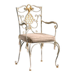 "Inviting Home - Wrought Iron Armchair - Hand-wrought iron armchair; overall: 21-1/2""W x 23""D x 38-1/2""H; seat: 18-1/2""W x 17""D x 20""H; back: 38-1/2""H; arms: 28-1/2""H; hand-made in Italy; Hand-wrought iron armchair with distressed white finish. This armchair has antique gold-leaf accents and fabric cushion with tassels. This chair is hand crafted in Italy."