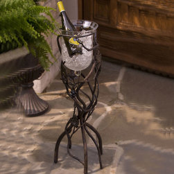 Vineyard Floor Wine Chiller - Present your marvelous vintage tableside at the right temperature with the Vineyard wine chiller. Great for dinner parties or casual enjoyment, this decorative chiller is a must-have for any budding connoisseur. Resting on a sturdy wrought iron base, the blown glass bucket affords for elegant serving. Filled with ice and it provides a cool container for a quick and even chill. This is a great accessory for any collection.
