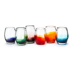 Handmade Colorful Glasses, Set of 6 - Handmade by Mexican artists, each piece in this festive glassware set is mouth blown from recycled glass to create six unique renditions of a stemless goblet. Their silhouette lends a sleek, modern touch to your tabletop, while the spectrum of ombre bottoms serve as colorful markers to help you keep track of your glass during a party.