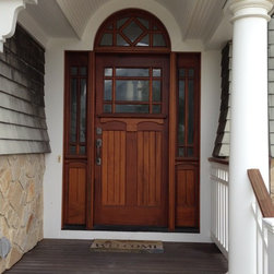 Unique third lite craftsman front entry door. - This entryway is as inviting as a piece of chocolate.  In fact it is hand crafted in the city famous for its chocolate, Hershey, PA.  The door is made from mahogany wood and features true divided lite panels in the door, sidelights and half round transom.  It is available in many configurations and sizes with or with out the sidelights or with a  rectangular transom.  You may also choose from a variety of wood types like chestnut, cherry, knotty alder, or even a reclaimed vintage wood.  Undeniably beautiful, this door suggests to all who pass through, the warmest of welcome.